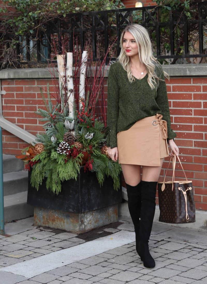 tan skort with green sweater