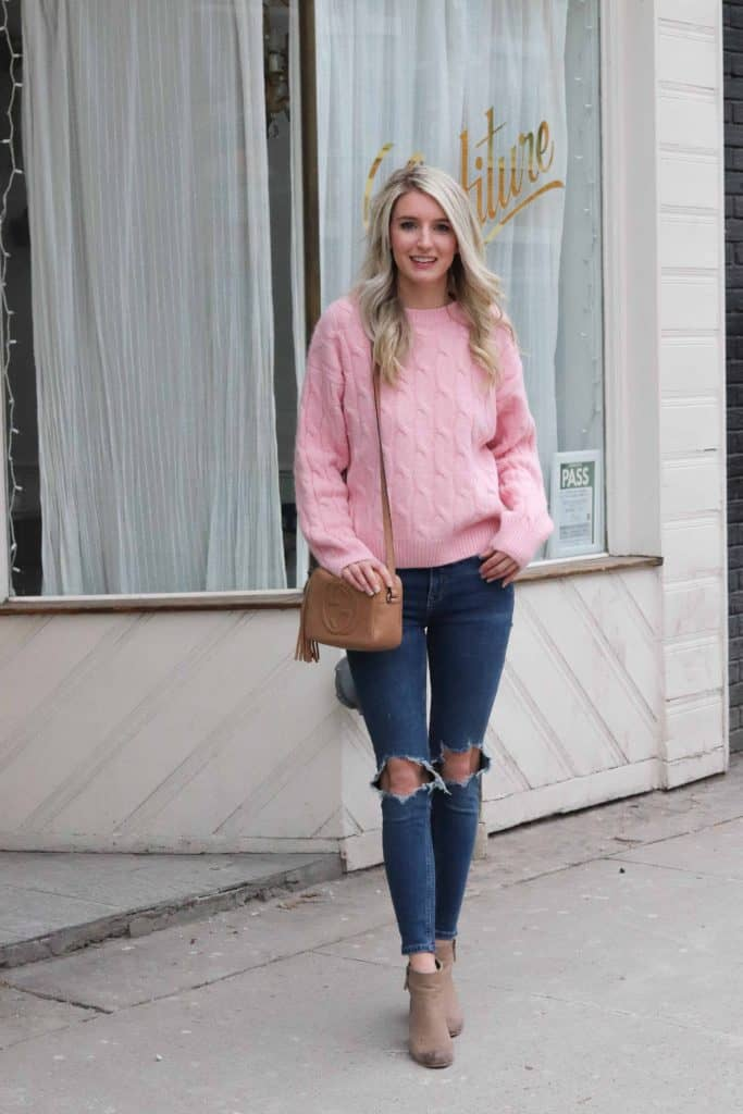 pink sweater and ripped jeans